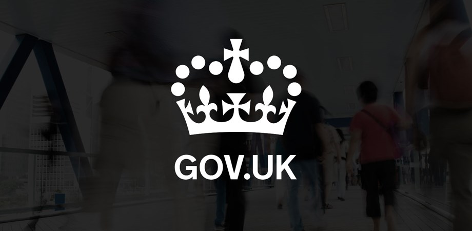 Gov uk crest with background of people walking
